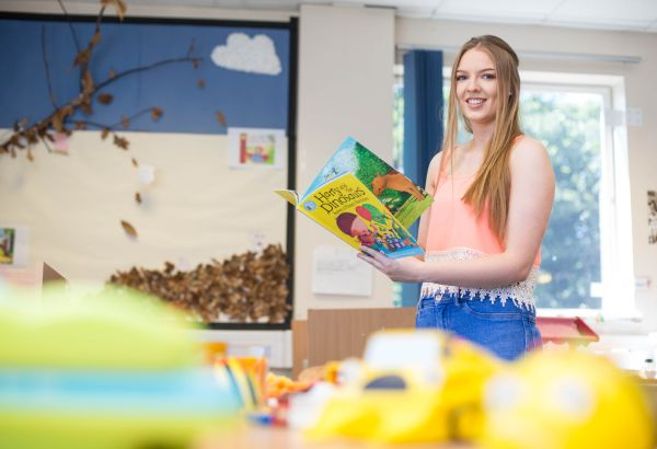 Student presenting a children's book in early years classroom