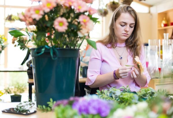 Floristry student creating their work