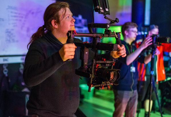 student-using-handheld-camera-with-stabilising-equipment