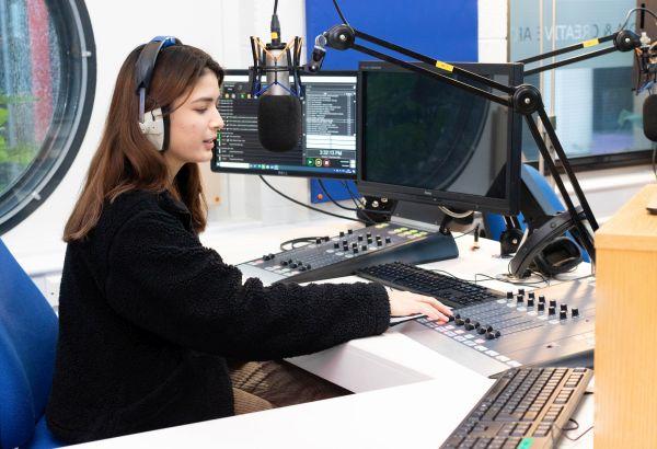 student-broadcasting-in-radio-studio