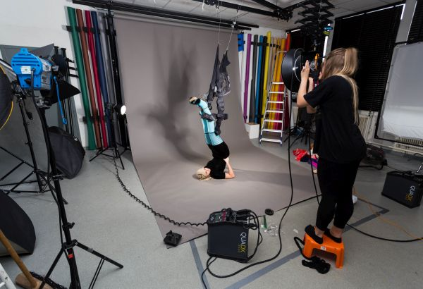Student doing a surrealism photoshoot in photography studio