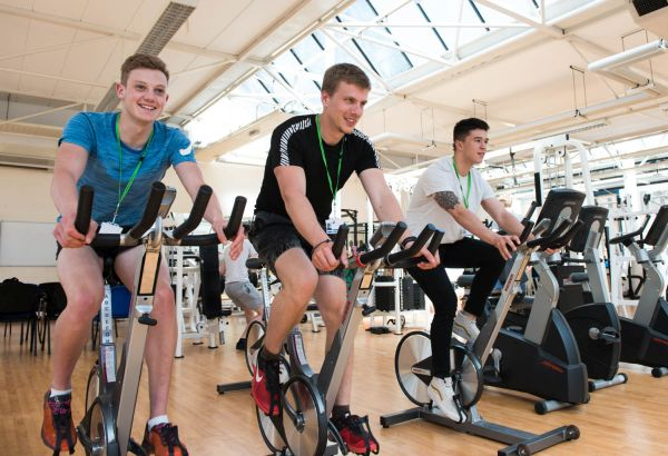 Students using exercise bikes in the University Centre's gym facilities