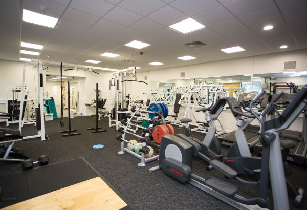 Refurbished gym facilities containing weights and exercise equipment