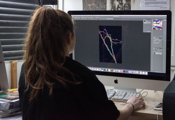 Student digitally editing their photograph on a Mac