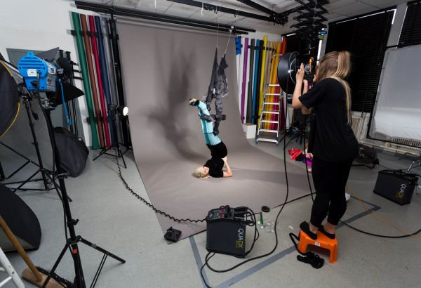 Photography student using a camera on a photoshoot