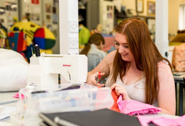 Fashion student working on a sewing machine