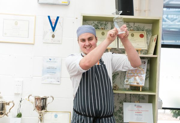 Young chef programme student with an award