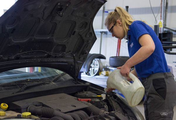 Motor vehicle student working on a car