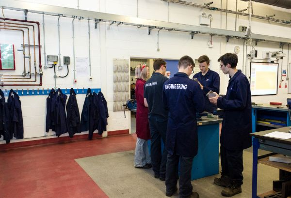 Group of engineering students in the workshop