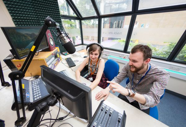 Student and lecturer in the college radio studio