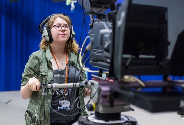 Student using the camera equipment in the media department