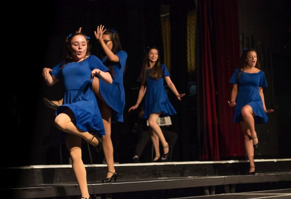 Performing arts students acting on stage