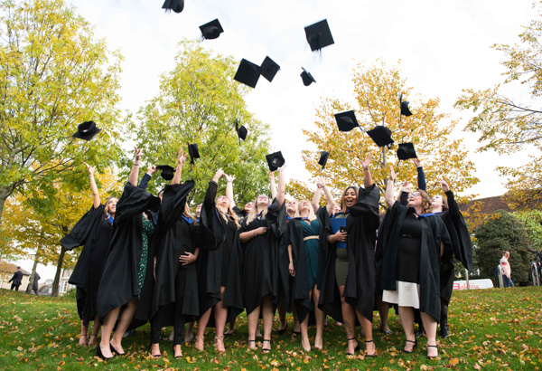Students throwing their hats at graduation