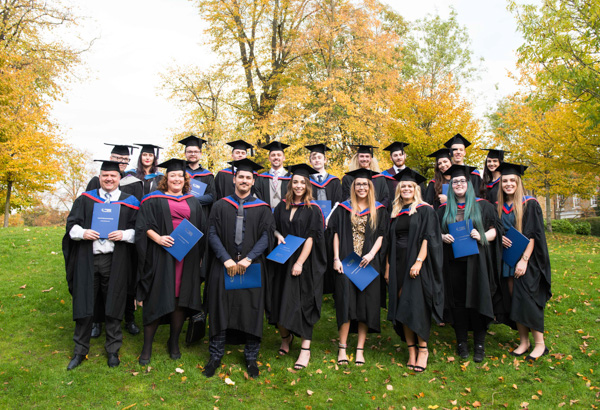 Large group of graphic design students at graduation ceremony