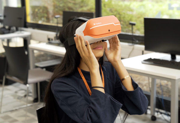 Student wearing virtual reality goggles