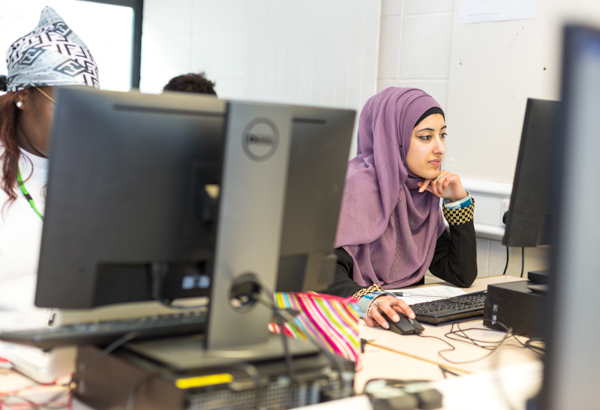 Student concentrating working on computer