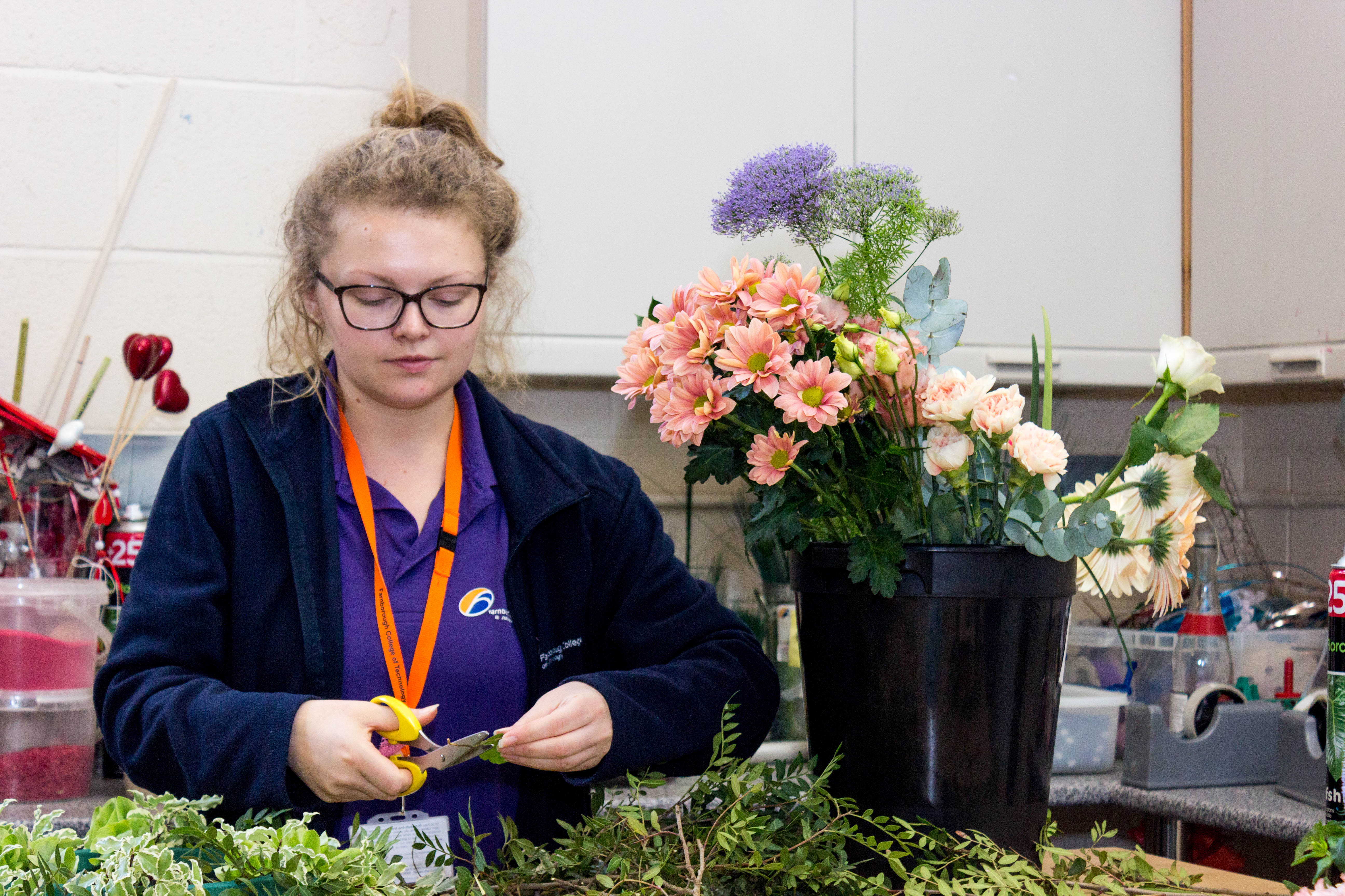 Floristry student set working in the floristy studio