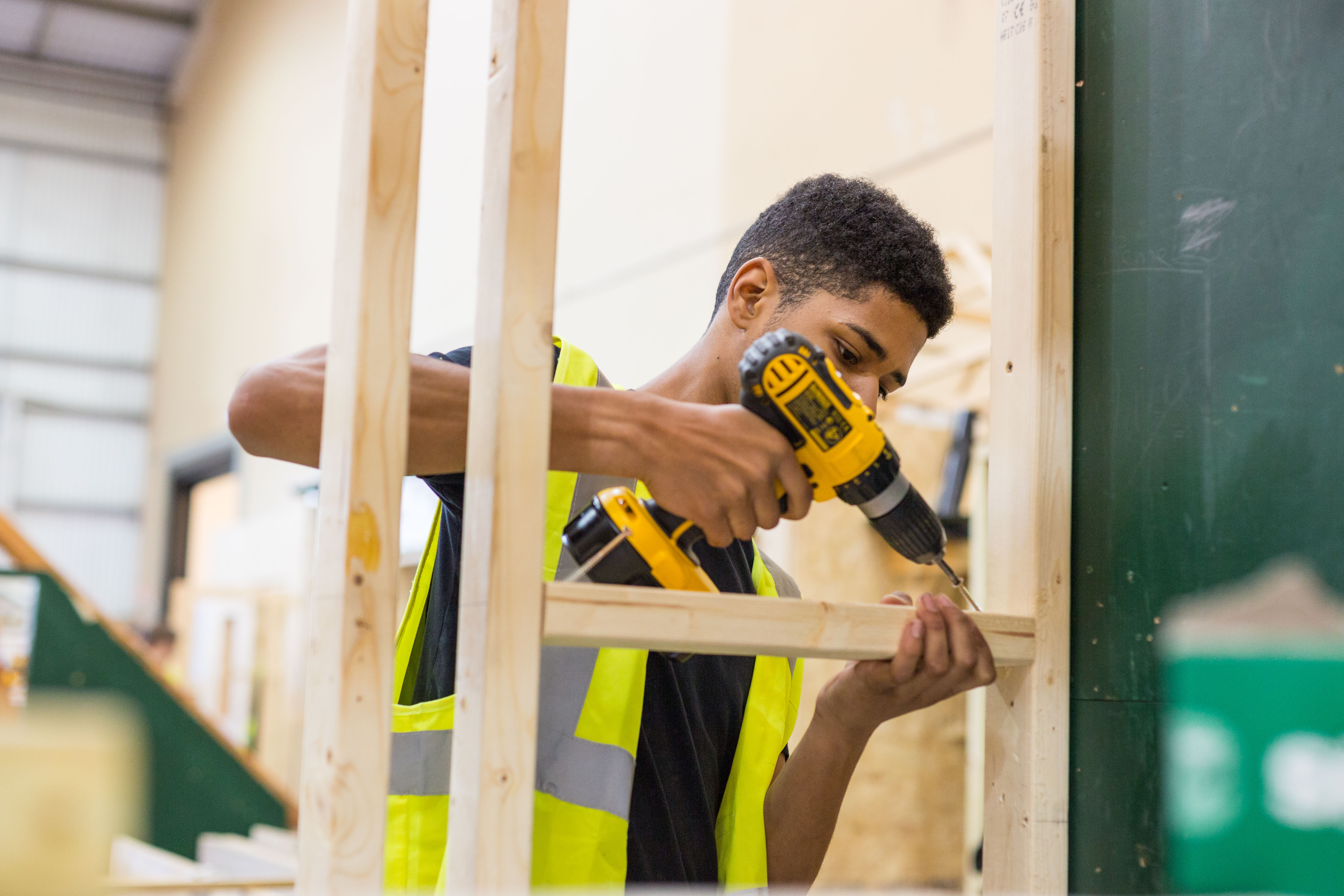 Male student working in the carpentry workshop