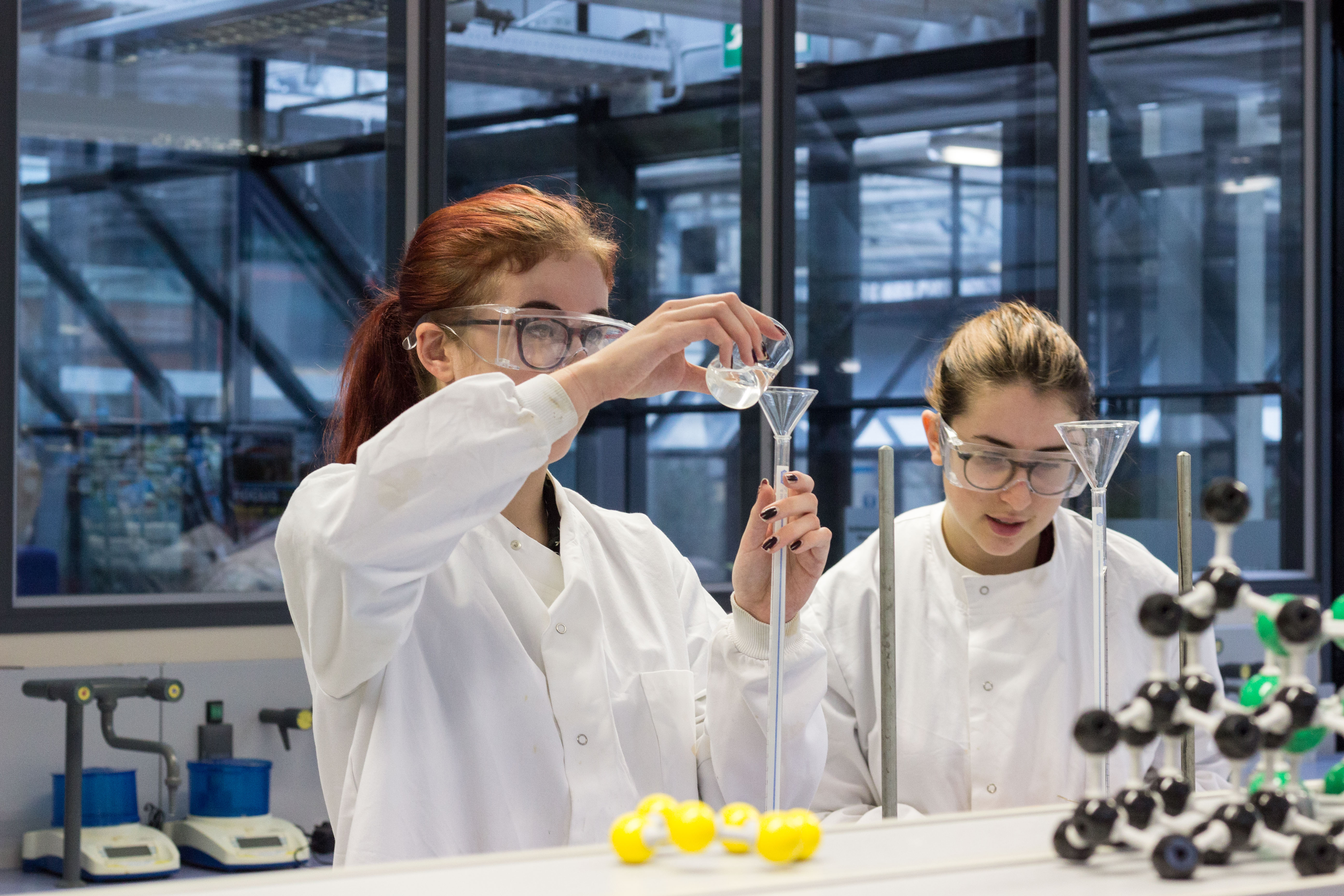 Girls working in the Science laboratory